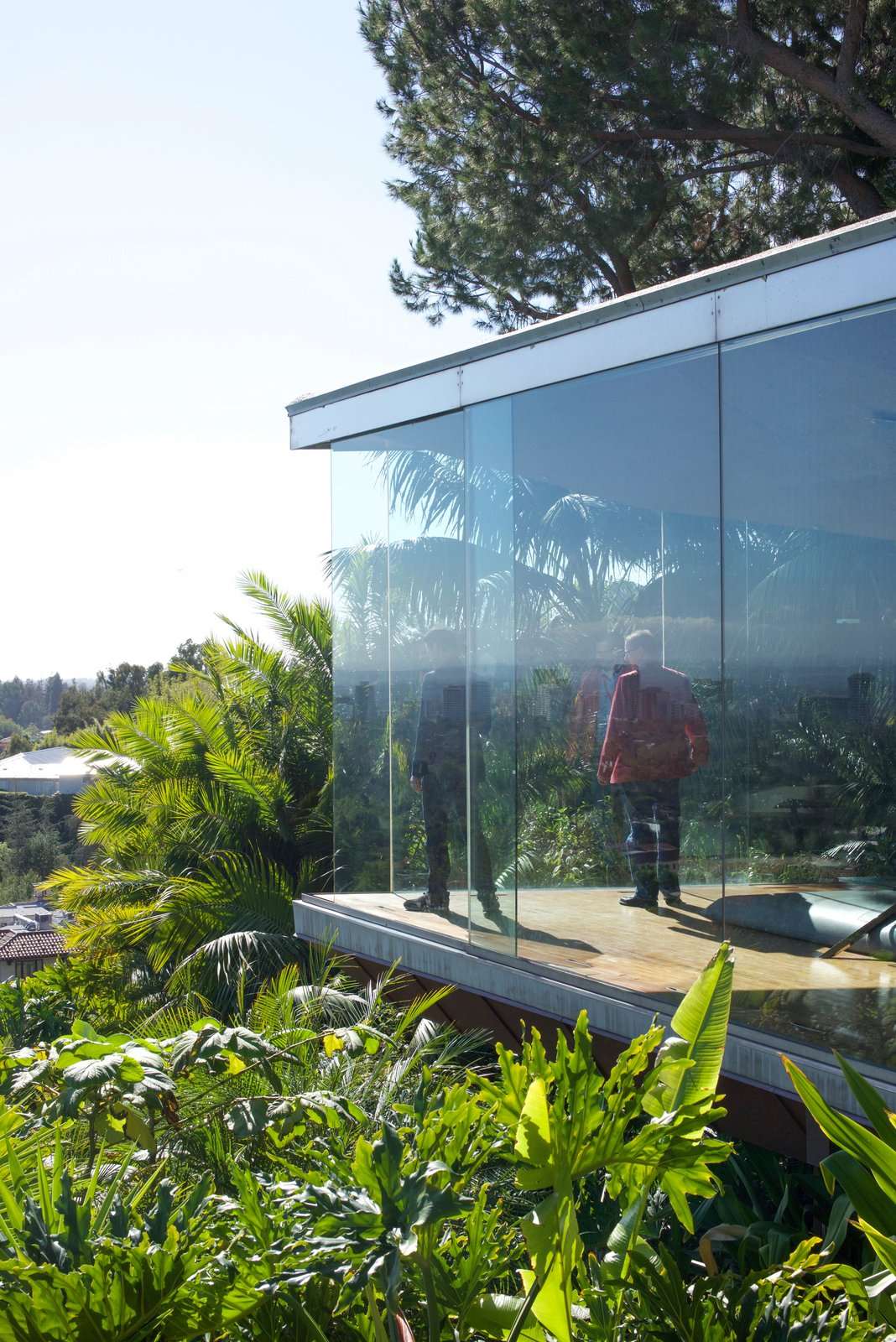 """The seamless glass opens up automatically at sharp points. This emphasizes the """"sense of danger"""" that's consistent throughout.  Behind the Scenes at John Lautner's Sheats-Goldstein Residence"""