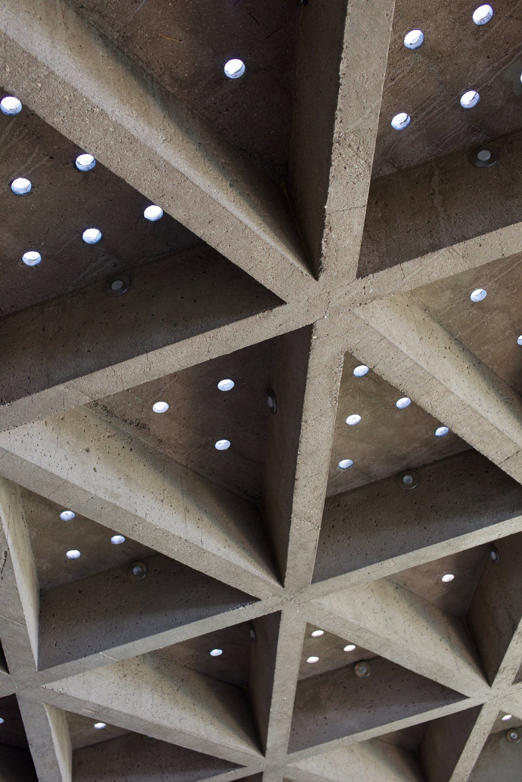 The ceiling is covered with sandblasted concrete that still has the original miniature circular skylights.  Behind the Scenes at John Lautner's Sheats-Goldstein Residence