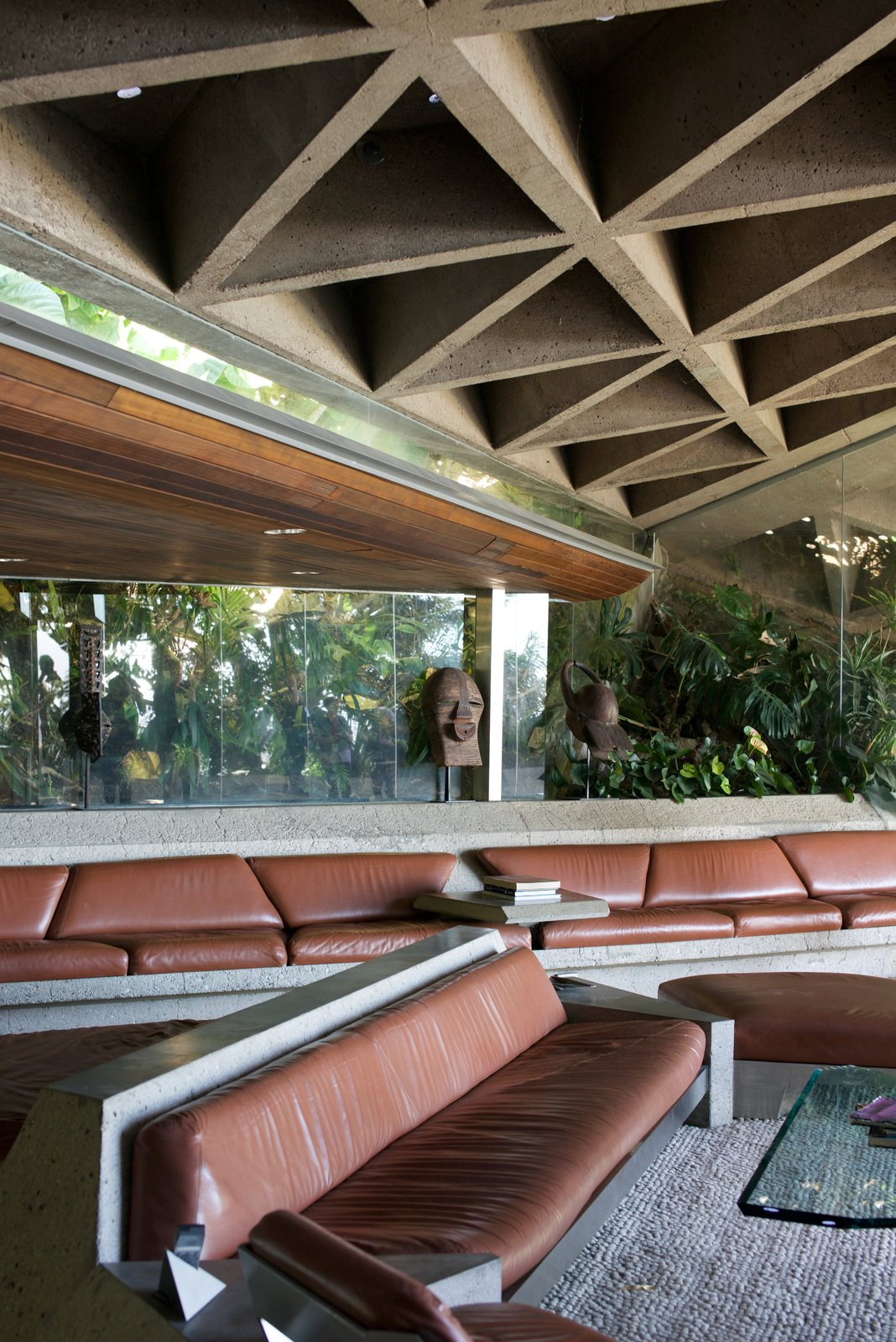 The famous living room is filled with custom leather-and-concrete sofas and geometric concrete ceilings.  Behind the Scenes at John Lautner's Sheats-Goldstein Residence