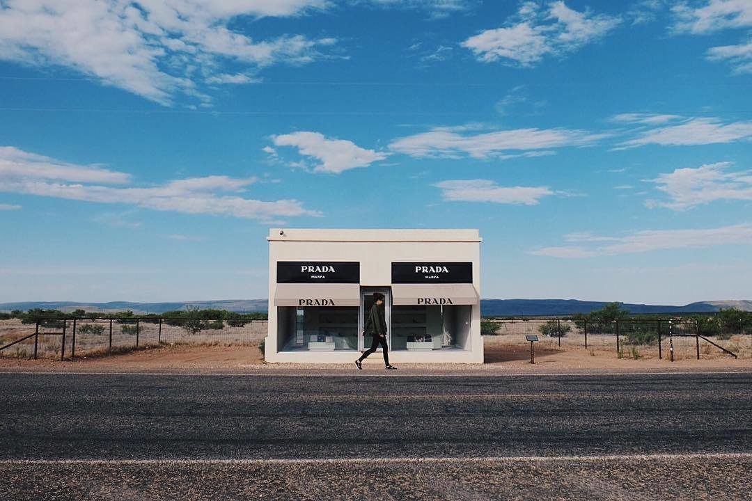 After being recovered from its fair share of vandalism, Prada Marfa has become a permanent part of the Texas landscape. Though the structure lacks a real door, the two large windows are filled with actual shoes and bags by Prada.