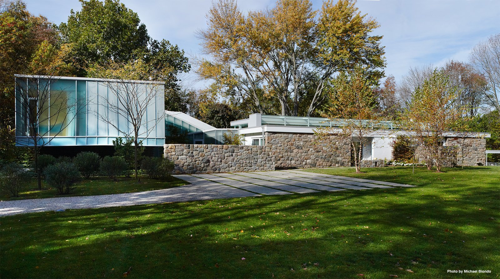 Looking towards the residence, you'll see the original main house to the right, and the steel and glass addition to the left—which are connected by stairways that lead up on one direction, and down on the other. The main house holds the communal living spaces while the addition holds the bedrooms.  Photo 3 of 9 in Marcel Breuer's Revived Home Could be Yours for Just Under $5 Million