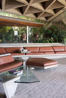 In the living room—which has become known as the Big Lebowski room—boasts a concrete-and-leather sofa that was a collaboration between Goldstein and Lautner. The ceiling is covered with sandblasted concrete that still has the original mini circular skylights.