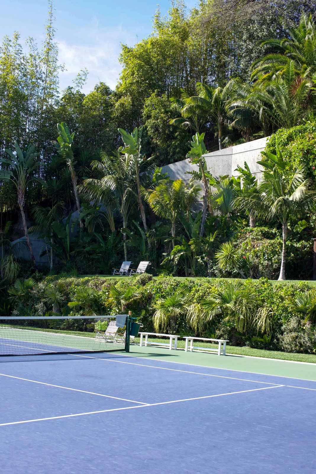 The colossal yard includes LA's only infinity tennis court and looks out to astonishing views.  Photo 6 of 9 in Iconic Perspectives: John Lautner's Sheats-Goldstein Residence