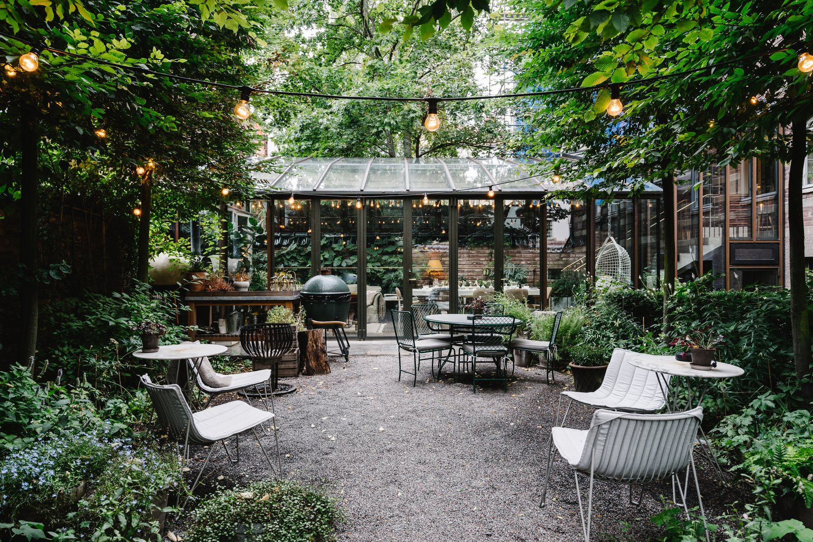 The courtyard holds outdoor seating and a fire pit. Ett Hem's chefs grill here for the evening meals.  Photo 10 of 13 in A Visual Journey Through Stockholm's Hotel Ett Hem