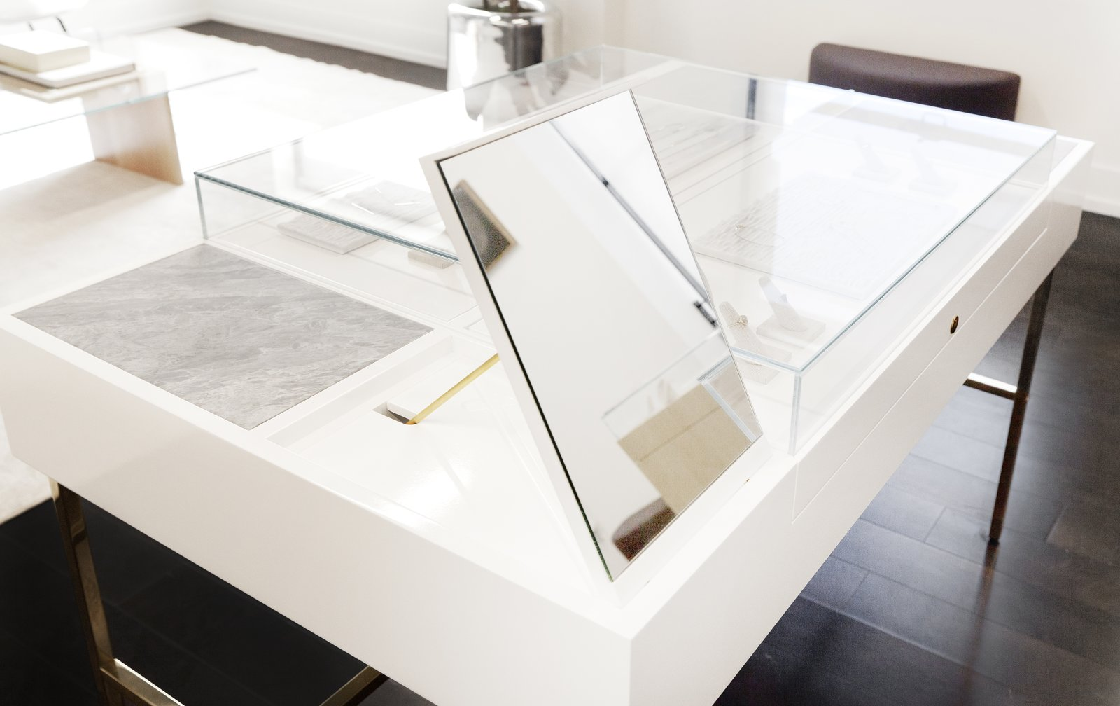 This particular display includes marble trays and mirrors that flip up while concealing ring sizers and additional stock.  Photo 7 of 10 in This New Jewelry Showroom Celebrates 'Made in L.A.' From Top to Bottom