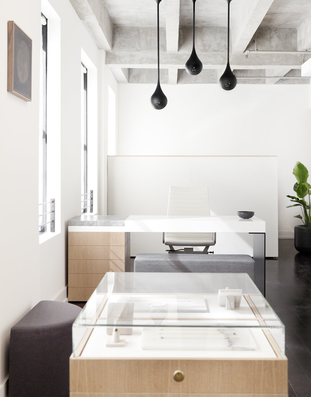 Above Lee's custom desk hangs three matte black Drop Light Pendants that designed by Early Work.  Photo 9 of 10 in This New Jewelry Showroom Celebrates 'Made in L.A.' From Top to Bottom