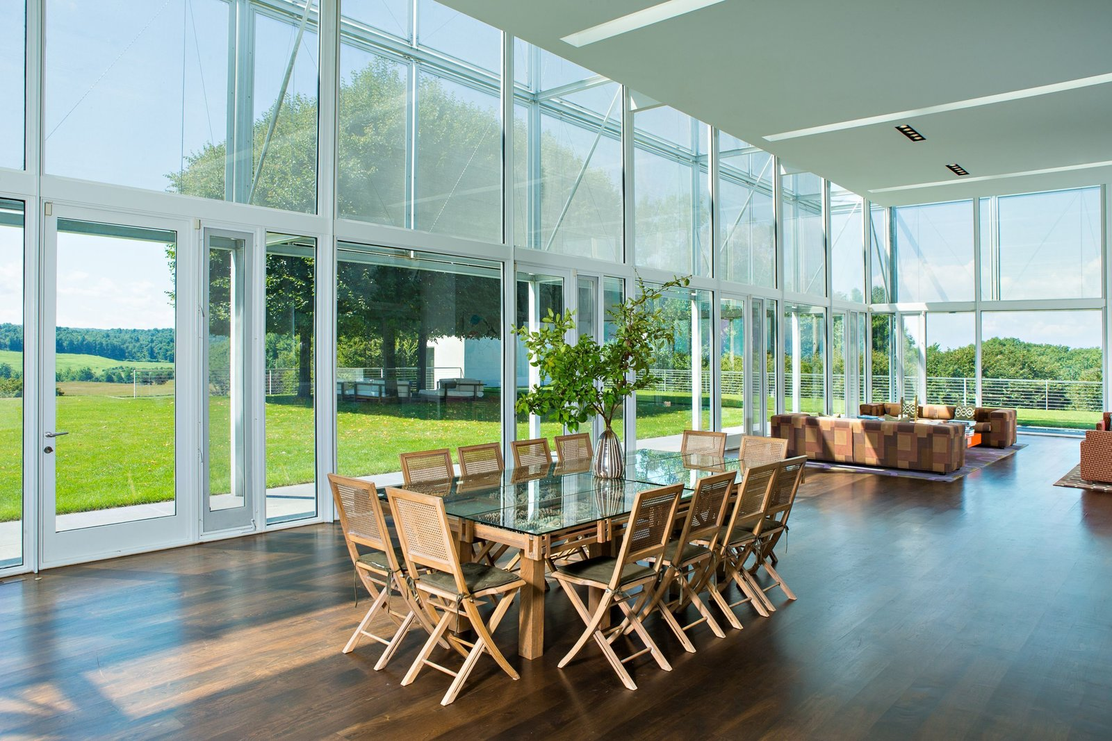 The main pavilion consists of a large light-filled area that connects a living and dining room. It boasts 360-degree views, thanks to the floor-to-ceiling glass.  Photo 6 of 15 in A Thomas Phifer-Designed Glass-and-Steel Masterpiece For Sale
