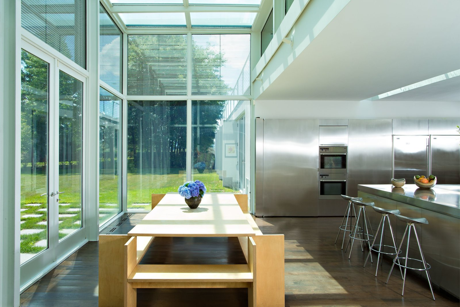 Adjacent to the reflecting pool is a chef's kitchen that's filled with expanses of stainless steel.  Photo 7 of 15 in A Thomas Phifer-Designed Glass-and-Steel Masterpiece For Sale
