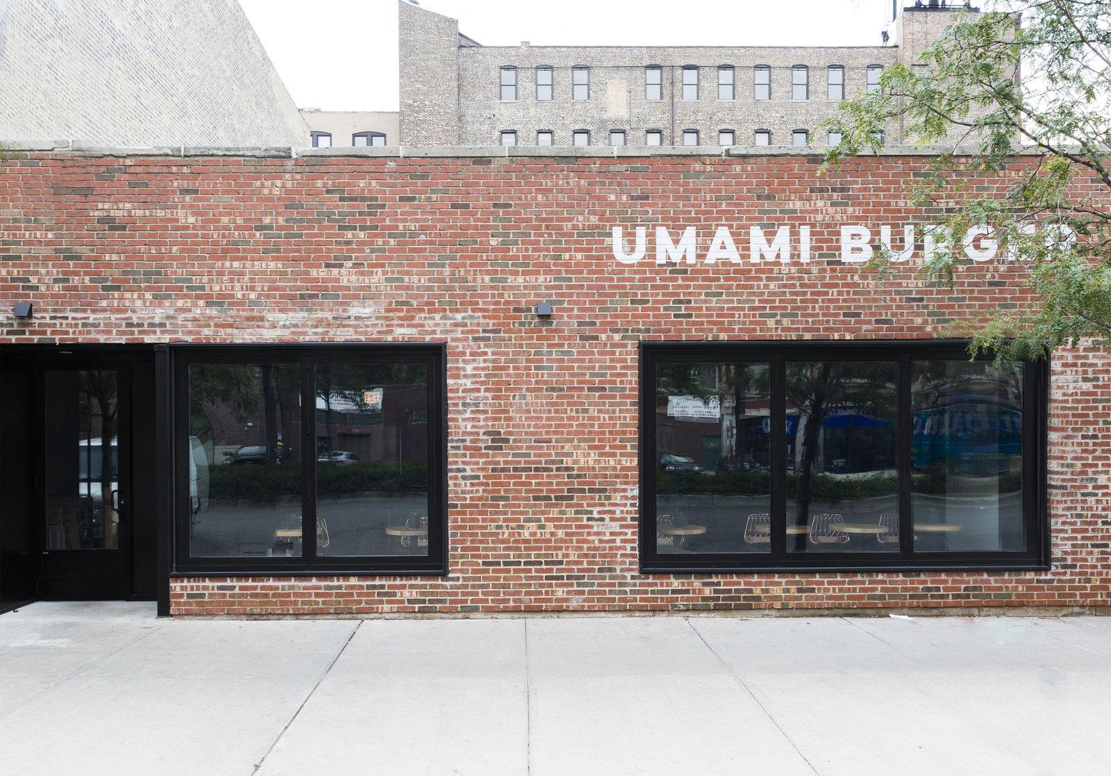 As one of the new locations, the facade of Umami Burger was left mainly untouched besides a simple, modern logo and dark black windows that keep the mystery alive.  Photo 2 of 9 in A Popular Burger Joint Flaunts Its Roots With the Help of a Design Collective