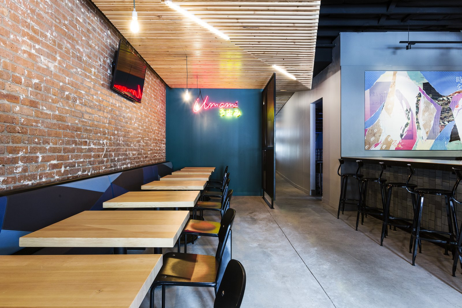 At this Chicago location, Project M Plus installed panels of custom wooden slats on the ceiling. The geometric shapes refer to the art of origami.  Photo 3 of 9 in A Popular Burger Joint Flaunts Its Roots With the Help of a Design Collective