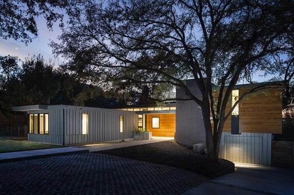 The flat-roof structure, which is constructed with metal siding and wood, is located at 1906 Airole Way in Austin, Texas.  Photo 2 of 5 in A Glimpse Into a Remodeled Midcentury Abode in Austin