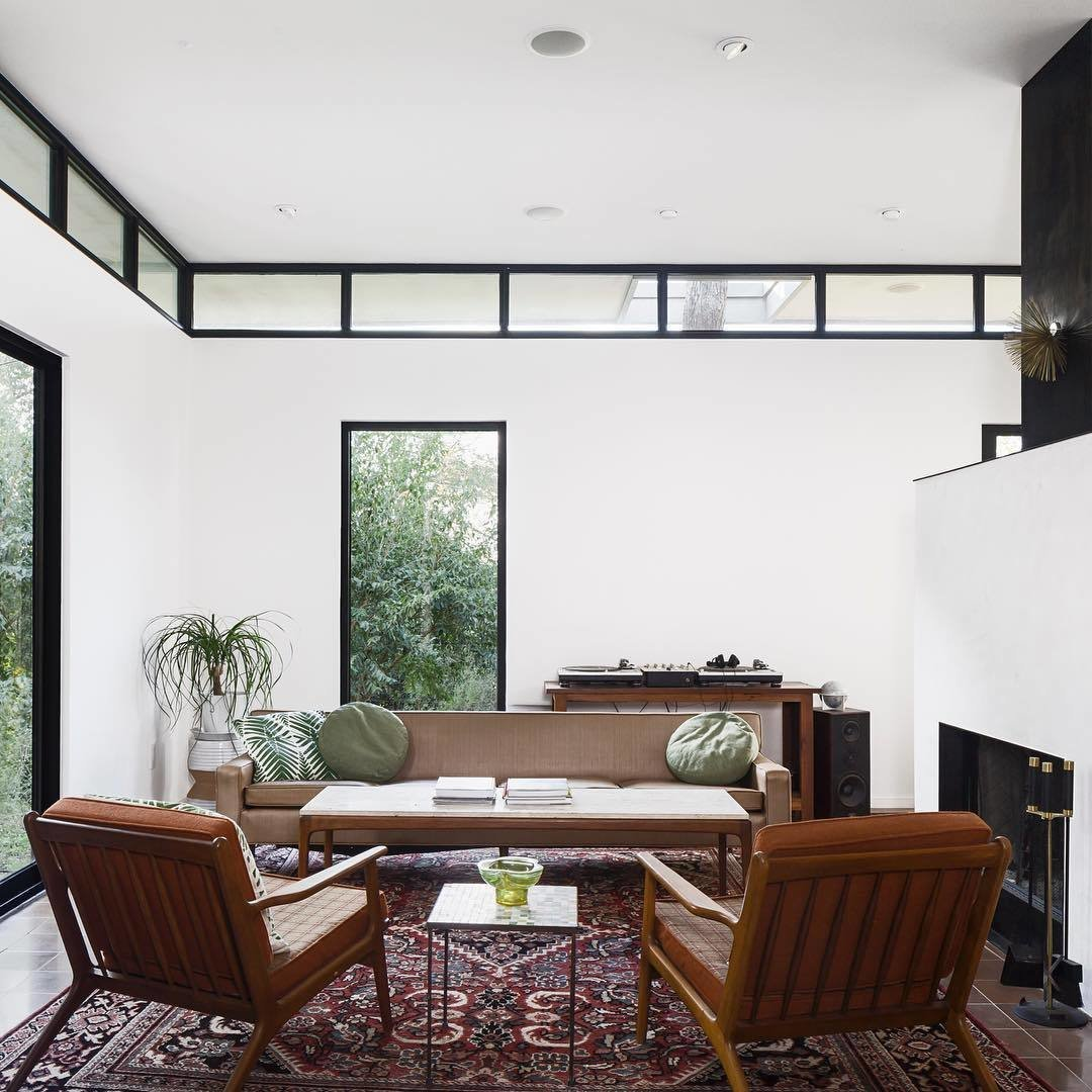 This photo that Calo took of the central living space is marked by tall ceilings, clerestory windows, and a cold-rolled steel fireplace.  Photo 3 of 5 in A Glimpse Into a Remodeled Midcentury Abode in Austin