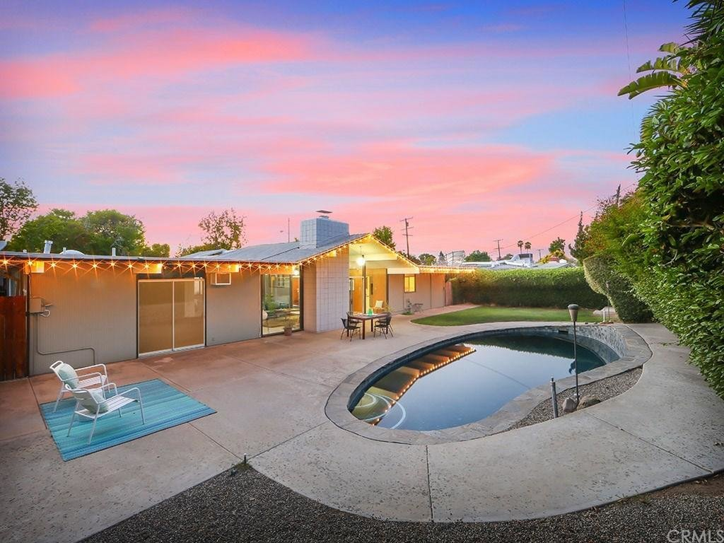 The bean–shaped pool and small grassy area gives you the chance to enjoy the Southern California climate year-round.  Photo 8 of 8 in This Quintessential Eichler Will Hit All Your Midcentury Goals—and It's For Sale