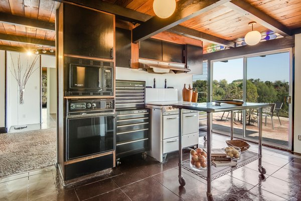 If you look carefully, you'll see sections of stained glass throughout the house, which was possibly created by the original architect.  Photo 8 of 10 in This Midcentury Home For Sale Is Not Your Regular Ranch House