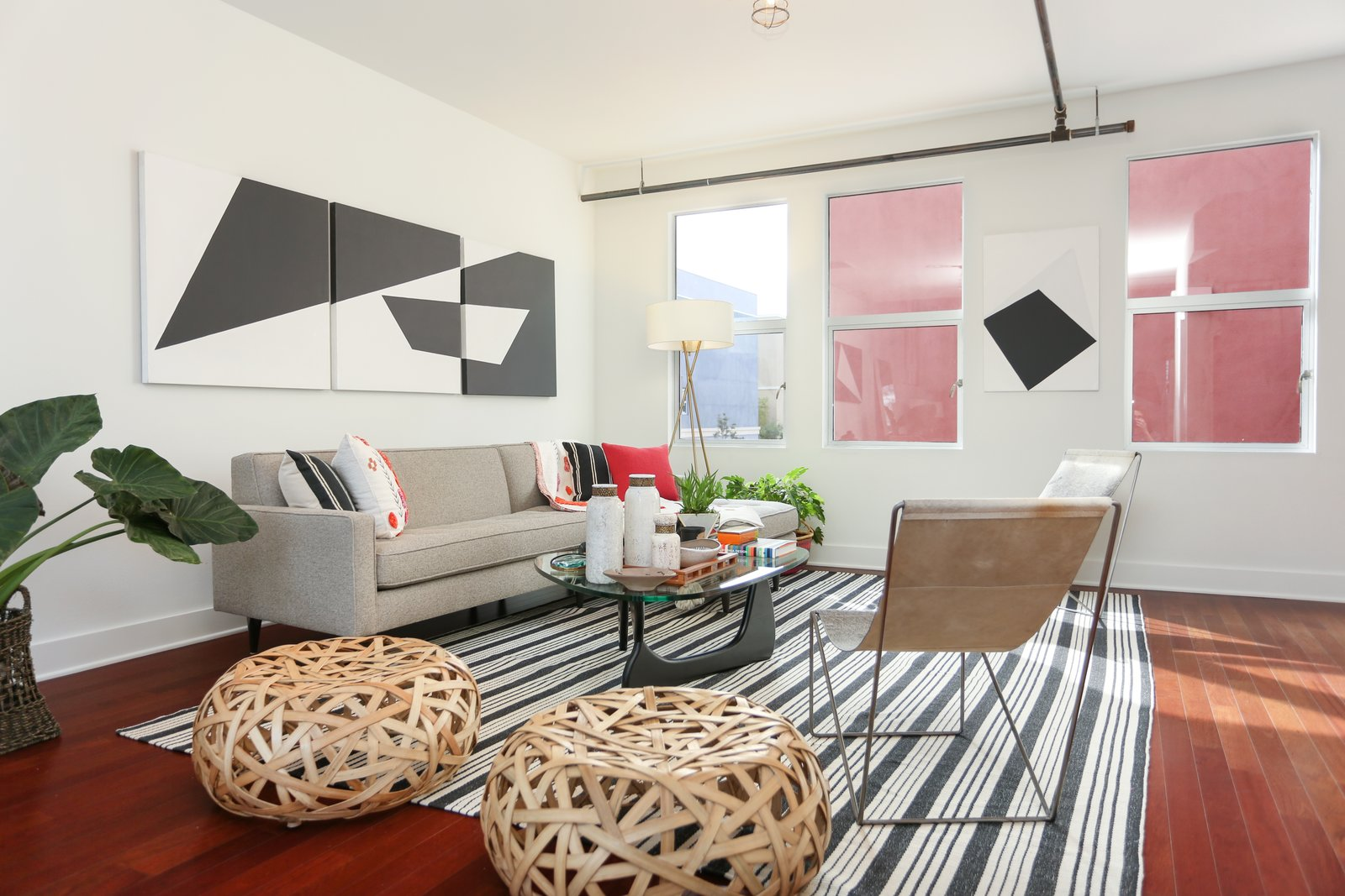 The second floor is separated from the main floor, and offers a private open living space that's connected to the upgraded kitchen.  Photo 3 of 9 in A Designer Lists Her Three-Story Live/Work Loft in Orange County for $525K