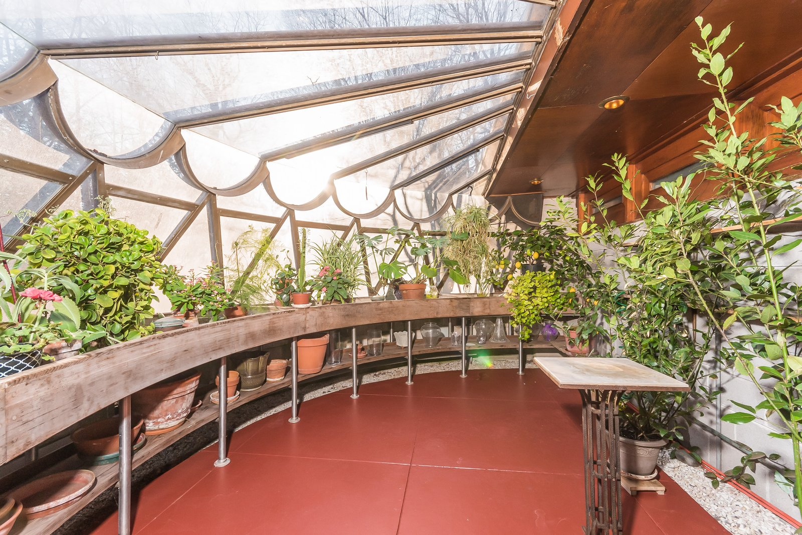 The greenhouse features windows that are finished with a scalloped metal detail. We we were speaking on the phone, Gricar made a realization that this metal scalloping can also be found on the Guggenheim—solidifying a nice connection to the other project that was on his mind at the time.  Photo 9 of 11 in Frank Lloyd Wright's Last Major Residential Masterpiece Could Be Yours for $7.2 Million