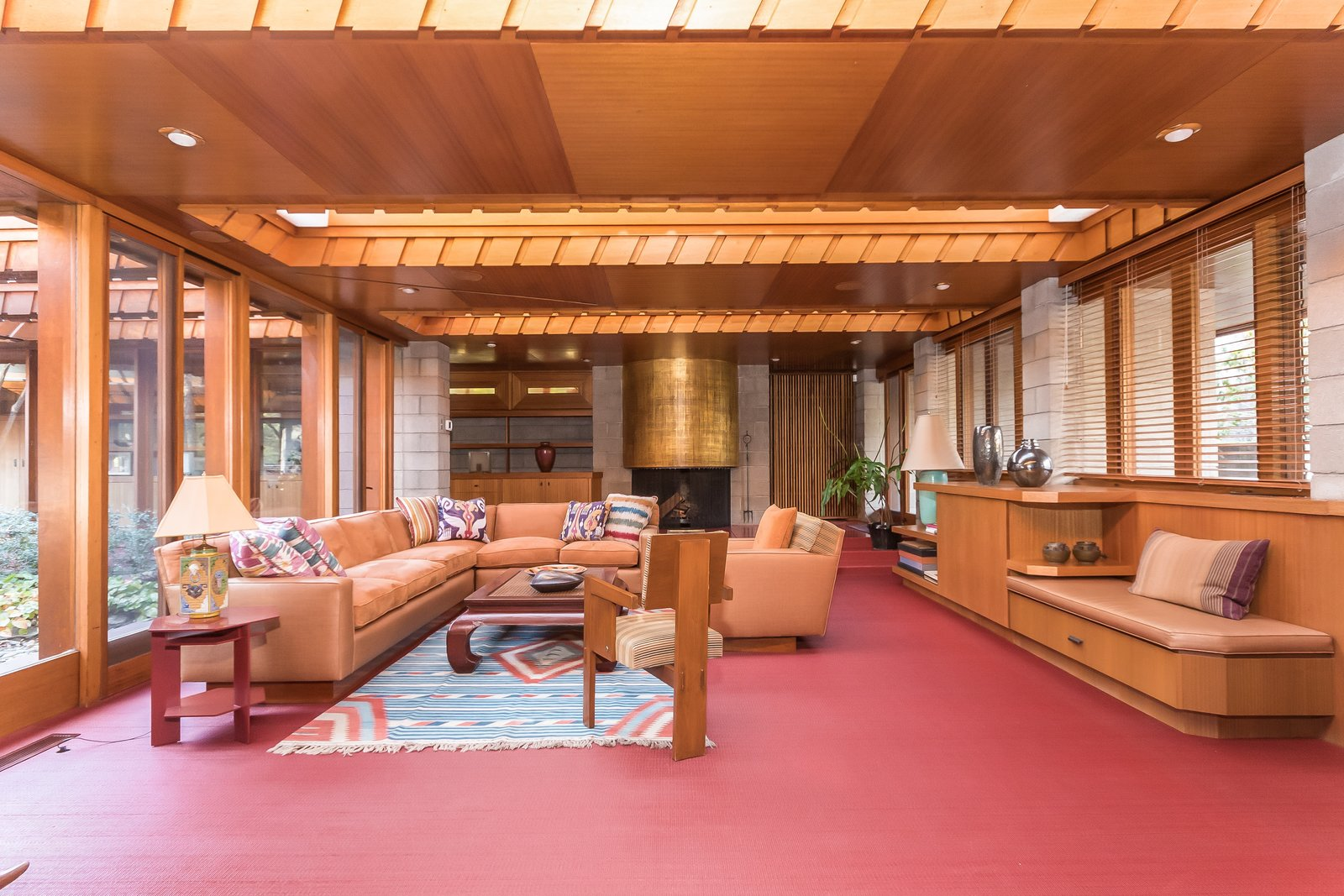 In the family room—which also holds a gold leaf-covered concrete fireplace—large skylights run the width of the space.  Photo 5 of 11 in Frank Lloyd Wright's Last Major Residential Masterpiece Could Be Yours for $7.2 Million