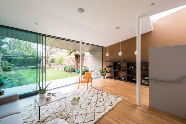 A deck leads out to a southwest-facing garden with a shed that's hidden by a yew hedge.  Photo 7 of 9 in A Fusion of Old and New Makes this Home For Sale Shine on London's Womersley Road