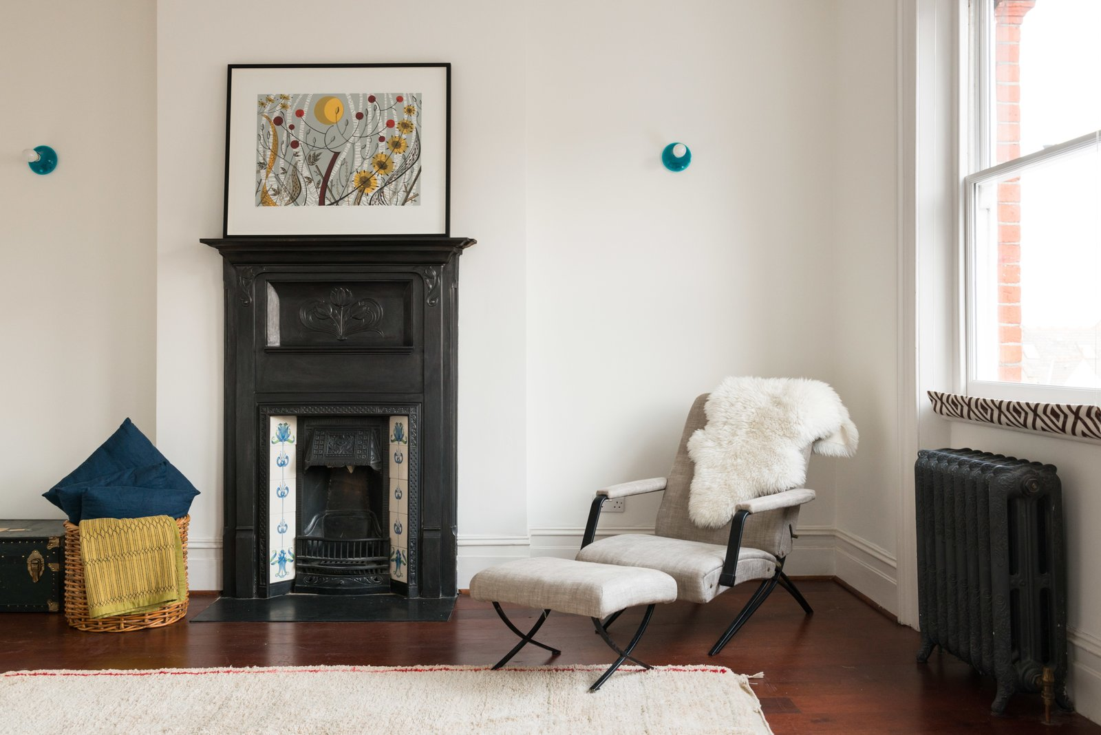 This bedroom shows another example of how they preserved certain characteristic elements including the original fireplace and radiators.  Photo 9 of 9 in A Fusion of Old and New Makes this Home For Sale Shine on London's Womersley Road