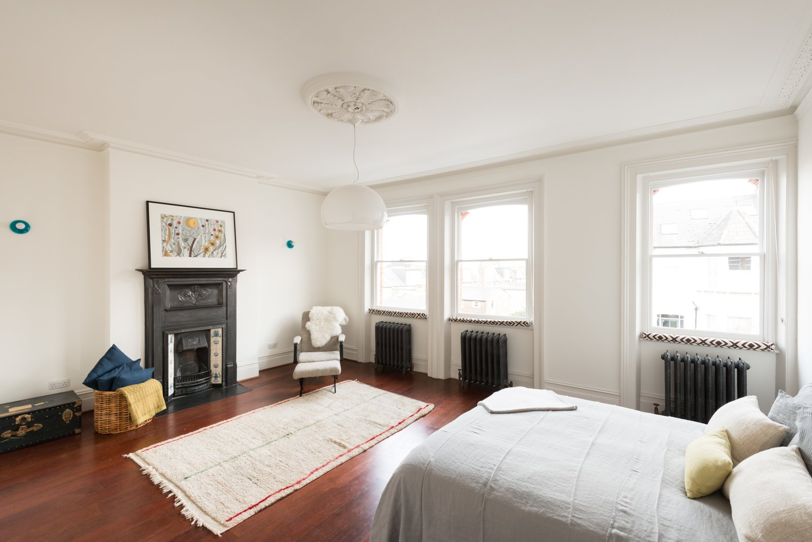 Among the five bedrooms is a master suite in the eaves that has an en-suite bathroom, freestanding bath, and a dressing area complete with under-eaves storage.  Photo 8 of 9 in A Fusion of Old and New Makes this Home For Sale Shine on London's Womersley Road
