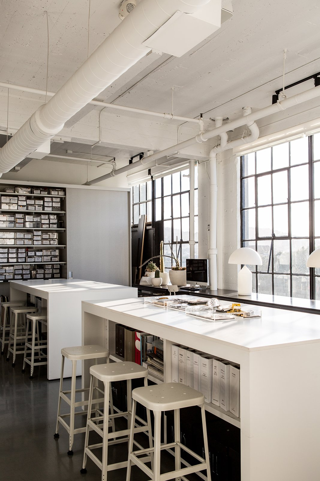 Hollis made sure to create areas where vendors, artists, and artisans can drop off their work or samples. Shown here is the materials library and high-top tables that provide storage and allow for casual, impromptu meetings.  Photo 10 of 13 in A San Francisco Design Collective Reveals its Impeccably Cool Creative Studio