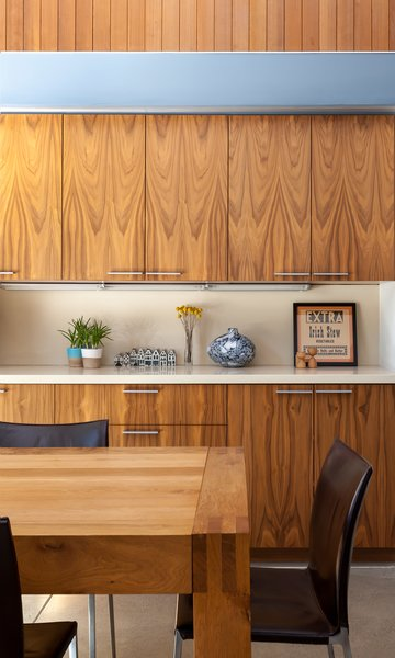 They installed walnut cabinetry and vertical boards made of clear western cedar with a simple oil finish.