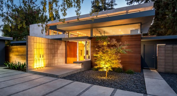 Jay and Melissa embraced the general configuration of the original house, which was a low, broad home that stretches out horizontally. While they remodeled and renovated the two wings on the sides, the blue sections are original. The cedar and stucco elements were new additions.