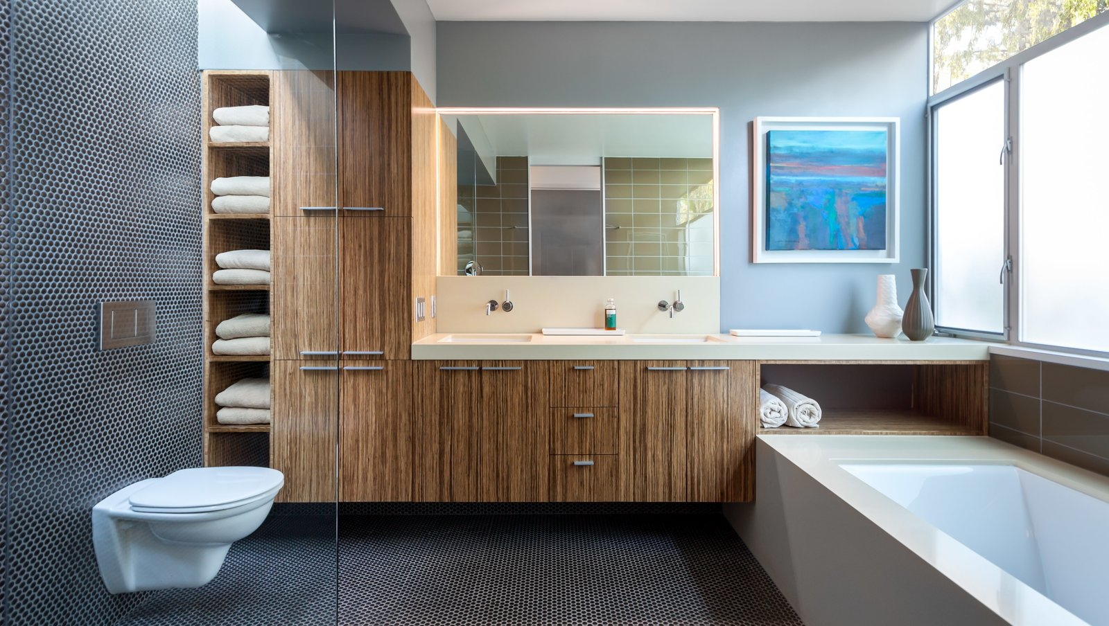 In the master bathroom, they installed bamboo cabinetry from Plyboo, a San Francisco-based company that thrashes and presses bamboo into dense logs that are then sliced and fabricated into the surface of your choice.  Photo 10 of 11 in A Year of Careful Study Leads to a Thoughtful Renovation of a 1949 Eichler