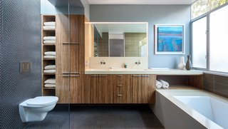 In the master bathroom, they installed bamboo cabinetry from Plyboo, a San Francisco-based company that thrashes and presses bamboo into dense logs that are then sliced and fabricated into the surface of your choice.