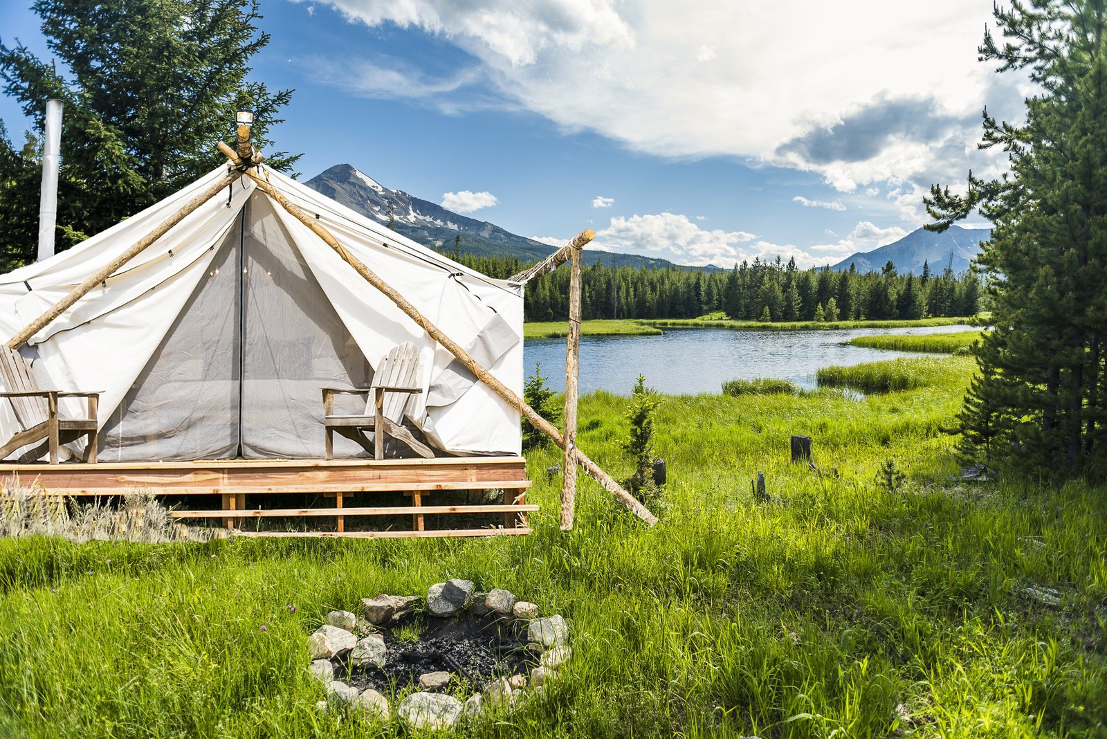 Exterior and Tent Building Type The team behind Collective Retreats built the custom canvas tents with wood that they sourced locally. They used timber they found in the property's vicinity to hold the peaks together at the top. Shown here is the Yellowstone location.  Photo 3 of 12 in Get the Modern Camping Experience You Crave at One of These New Secluded Retreats