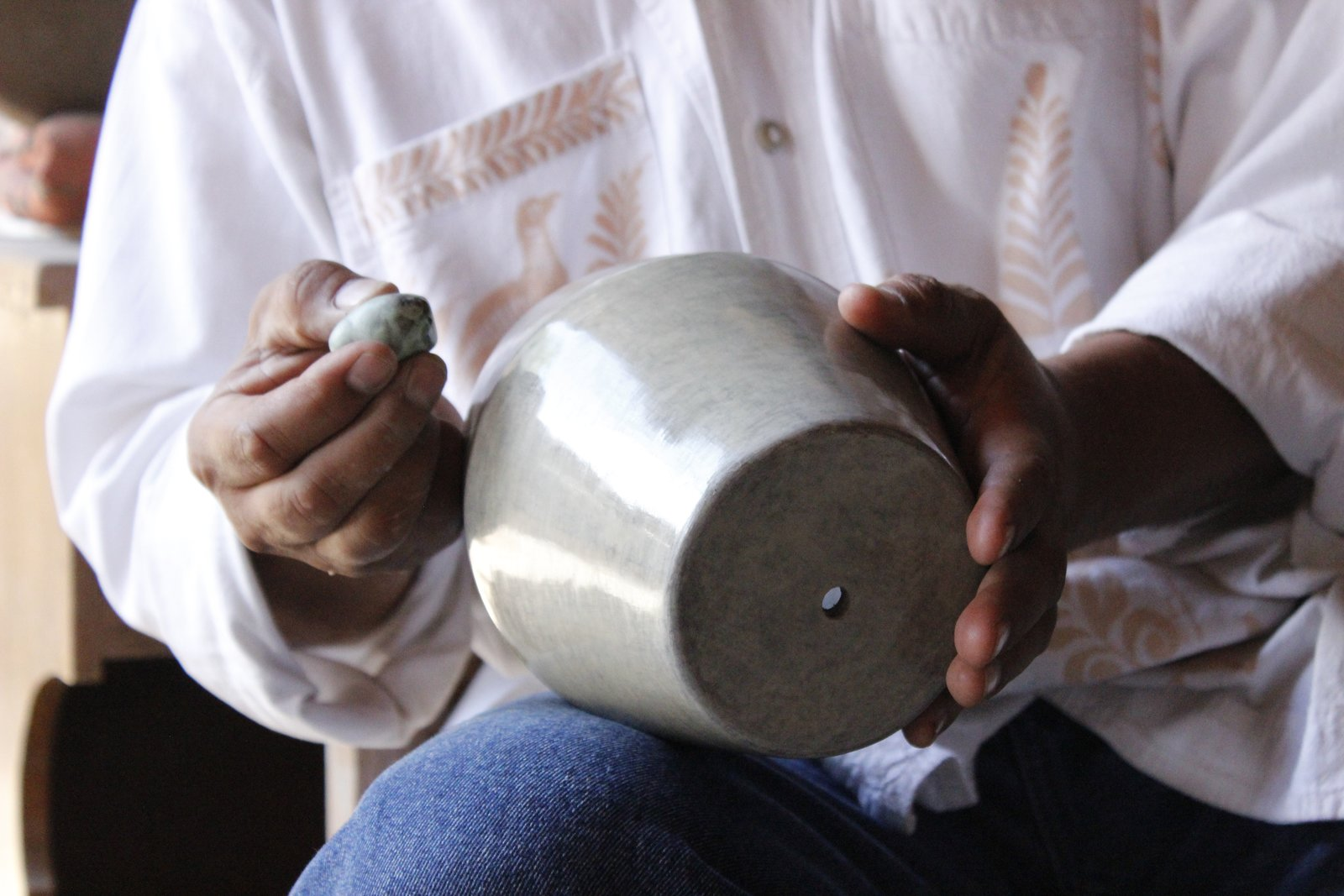 Another technique that they use to produce their lights is bruñido pottery, which hails from Tonalá, Jalisco, a city that's become known as the cradle of pottery—thanks to the vast deposits of clay found in the area. This technique includes multiple steps using pyrite, sandpaper, and river stones to smooth the clay into a buttery, smooth surface—all even before it's fired.  Photo 16 of 16 in Caravana Americana Showcases the Passion of Latin America's Design Community