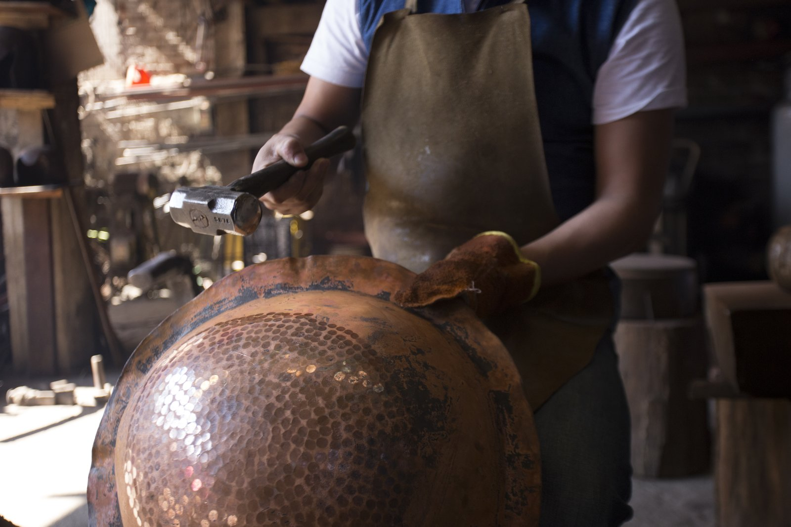 One of the traditional techniques that Filamento is fostering is working with hammered copper in Santa Clara del Cobre. For years, this skill has supported the principal commercial activity of this town, and includes knowledge that's been passed down for generations. To create these pieces, eight or  more craftsmen work together at the same time around an anvil. The copper is literally pounded when it's a state that's hot enough to be formed a certain way.  Photo 15 of 16 in Caravana Americana Showcases the Passion of Latin America's Design Community