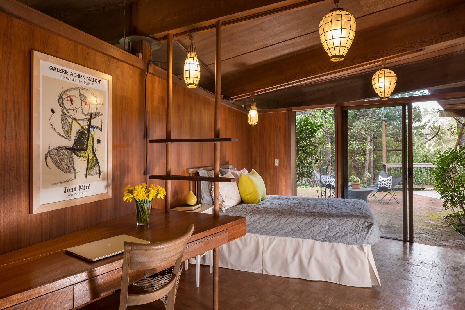The guest bedroom in the main house holds a built-in desk that was installed by Little's father, who took inspiration from the lines and shapes throughout the rest of the house.  Photo 10 of 17 in The Midcentury Home That Daniel Liebermann Built For His Parents Asks $2.8 Million