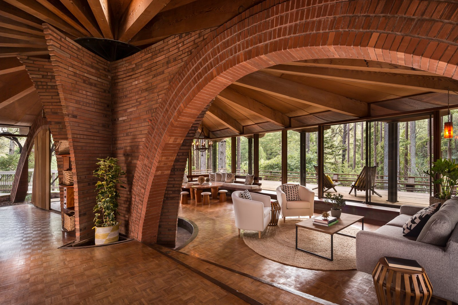 Liebermann and his wife Eva did the brickwork in the house—the most impressive section being the two arches that hover over the living areas and are surrounded by the home's old-growth redwood structure.  Photo 4 of 17 in The Midcentury Home That Daniel Liebermann Built For His Parents Asks $2.8 Million