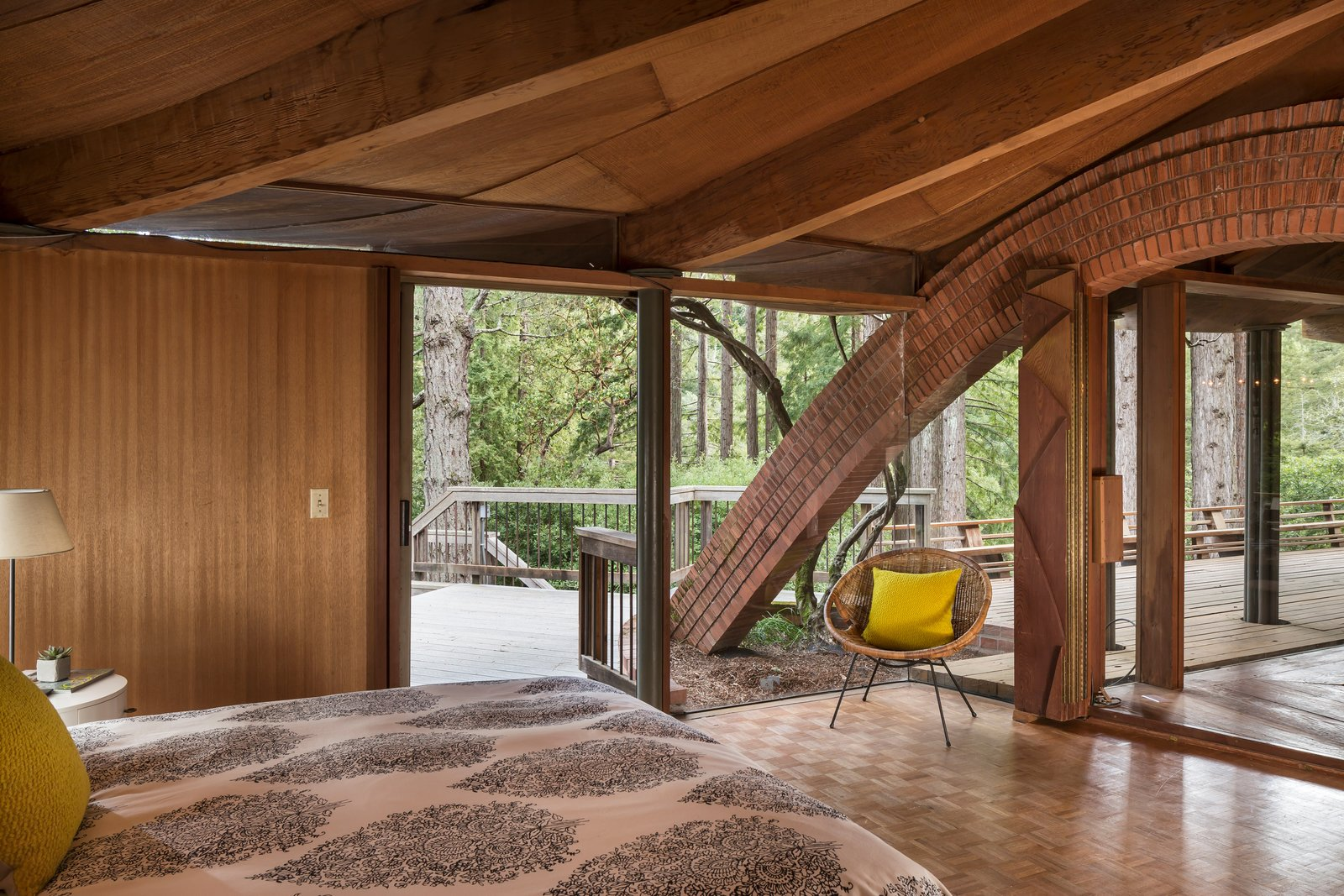 One of the brick arches connects to the master bedroom, which has an accordion door that can shut one side of the room to the rest of the living space.  Photo 8 of 17 in The Midcentury Home That Daniel Liebermann Built For His Parents Asks $2.8 Million