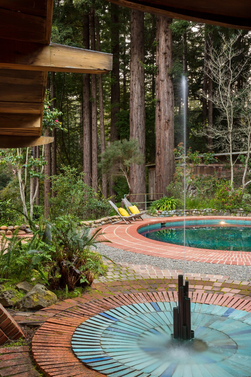 Both the pool and fountain feature original blue vertical tiles from Heath Ceramics, both of which are still functional.  Photo 14 of 17 in The Midcentury Home That Daniel Liebermann Built For His Parents Asks $2.8 Million