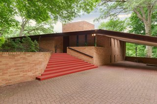 Though 2206 Parklands Lane is located near downtown Minneapolis, it sits on a quiet 3.77-acre piece of land. When you approach the brick home, its wing-like shape and Cherokee Red-painted steps practically scream Frank Lloyd Wright.