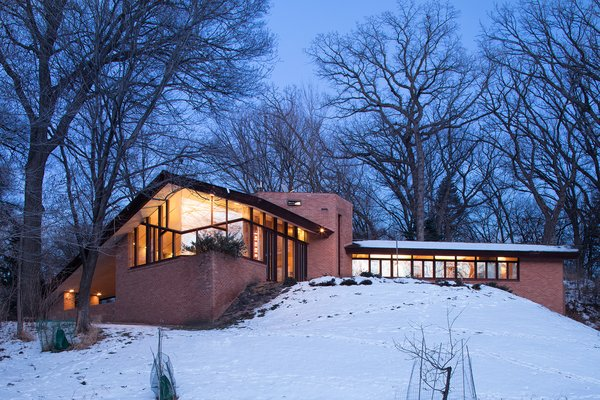 Like most of Wright's designs, the house is completely integrated into the landscape and was designed to bring the outside in through its placement in nature and its usage of extensive windows.  Photo 8 of 8 in The Original Homeowners of a Frank Lloyd Wright-Designed House Ask $1.3 Million