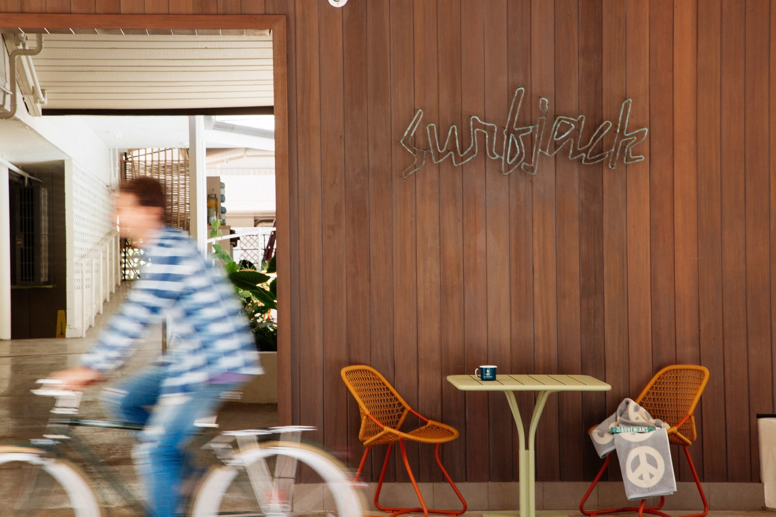 Dining Room, Chair, and Table When you first approach the Surfjack, a handmade copper sign welcomes you that was created by Jason Dow, a local jewelry designer.  The Surfjack Hotel & Swim Club from This Surf-Inspired Hotel Celebrates Waikiki's Creative Spirit and its Midcentury Roots