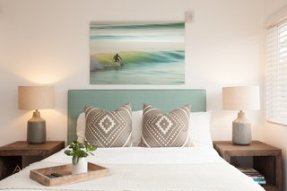The rooms are furnished with comfortable, contemporary, and beachy textiles, as well as artwork by local artists including Andy Davis, Daniella Manini, and Billy Watts. This piece above the bed is actually by Elisabet Harth, Nikki and Sander's mother.