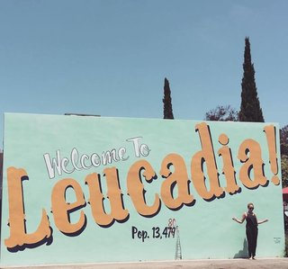 """A """"Welcome to Leucadia!"""" sign leads visitors with open arms onto the quaint block where Surfhouse sits. It borders a community coffee joint called Coffee Coffee, as well as Surfy Surfy, an old-school surf shop that began as a surf blog in 2005 where JP St Pierre documented his family surfboard factory called Moonlight Glassing. In 2010, Pierre teamed up with a few of his surf buddies to open up Surfy Surfy, which is the same group that later opened up Coffee Coffee. Both destinations were part of a community effort to make sure local businesses continue to rule there."""
