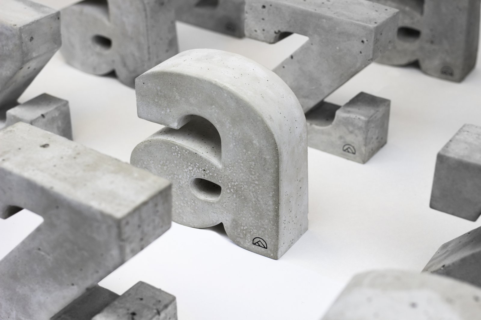 Concrete typographic bookends by  Andrew Ferrier and Corbin Dowd   Concrete Dreams from Brutal Beauty