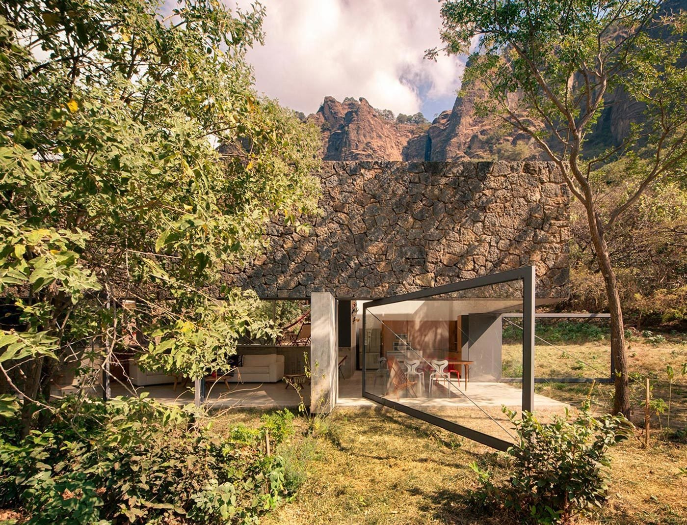 Outdoor, Trees, and Grass This retreat for two by Mexican architecture group EDAA flawlessly meshes with its surroundings in an elegant response to the landscape formed by native Tepoztecos over 500 years ago.  Photo 5 of 11 in 10 Retreats in Mexico For the Modernists Who Love the Outdoors from Casa Meztitla