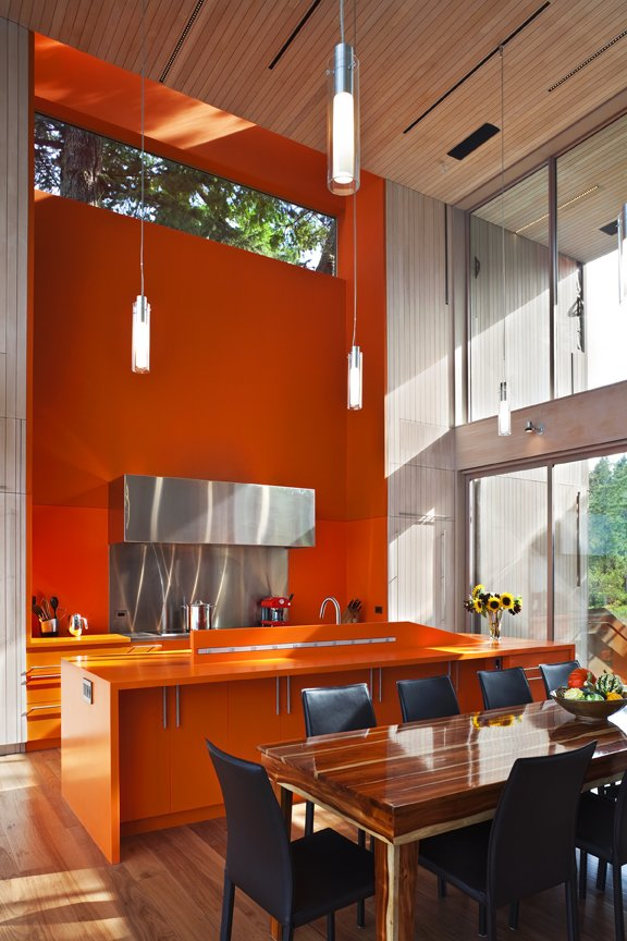 High ceilings in the kitchen and dining room  #kitchen #diningroom #orange #bright #color #beachhouse #beachhouses #vancouverisland #britishcolumbia #view #interstice #intersticearchitects #bradlaughtonphotography #bradlaughton Comme  TreeHugger