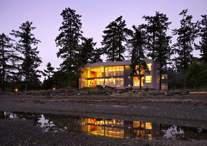 "View from the beach at low tide. The house dwells lightly on the beachfront, providing the unique spatial intimacy of being in and among the trees and in between the wild ocean and the soft wetlands. The projects creates an incomplete ""room without walls"" from which to enjoy the pristine landscape in an atmosphere of stewardship and ecological sensitivity.   #residential #residentialarchitecture #beachhouse #beachhouses #interstice #intersticearchitecture #evening #view #nature #outdoors #britishcolumbia #comox #vancouverislands #bradlaughton #bradlaughtonphotography #facade   TreeHugger"