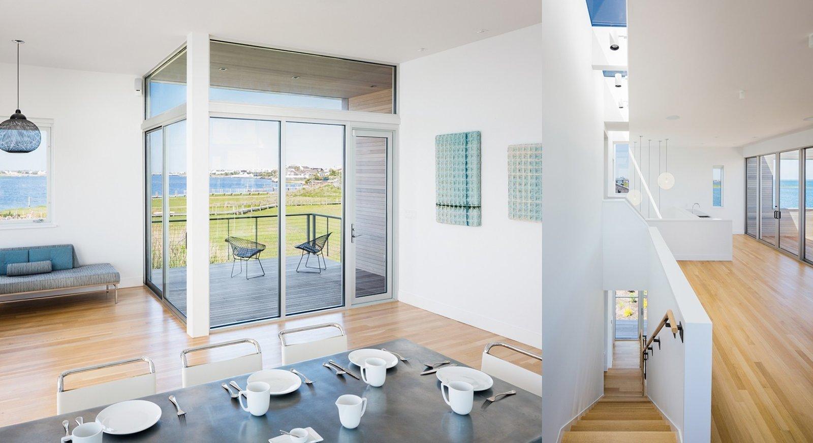 #CubeHouse #interior #inside #staircase #deck #chairs #seating #table #windows #naturallighting #dining #lighting #Westhamptonbeach #NewYork #LeroyStreetStudio   Cube House