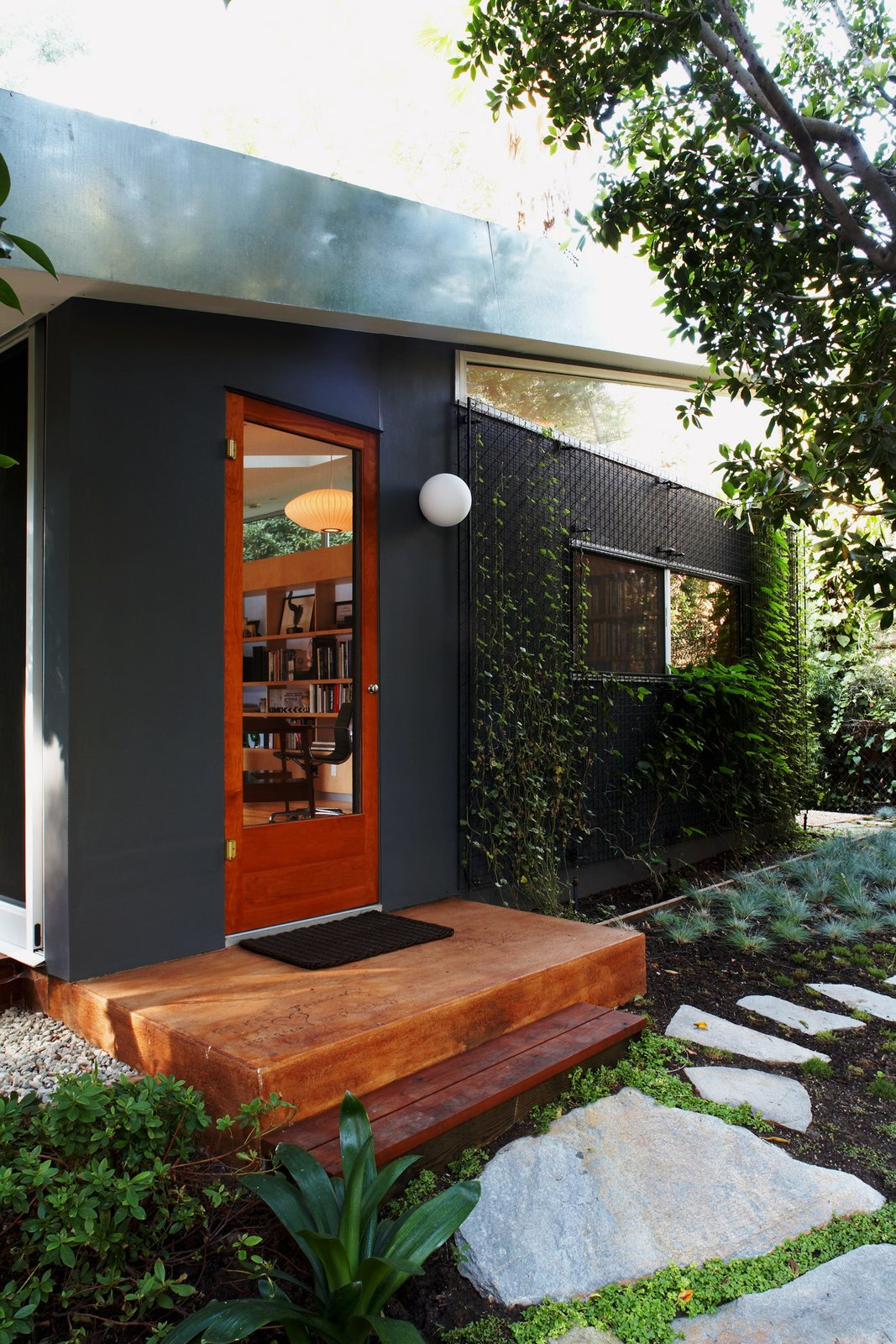 #LushHouse #modern #midcentury #hillside #seclusion #lighting #exterior #outside #landscape #plants #trees #pathway #door #wood #step #windows #detail #BeverlyHills #KingsleyStephensonArchitecture  Lush House