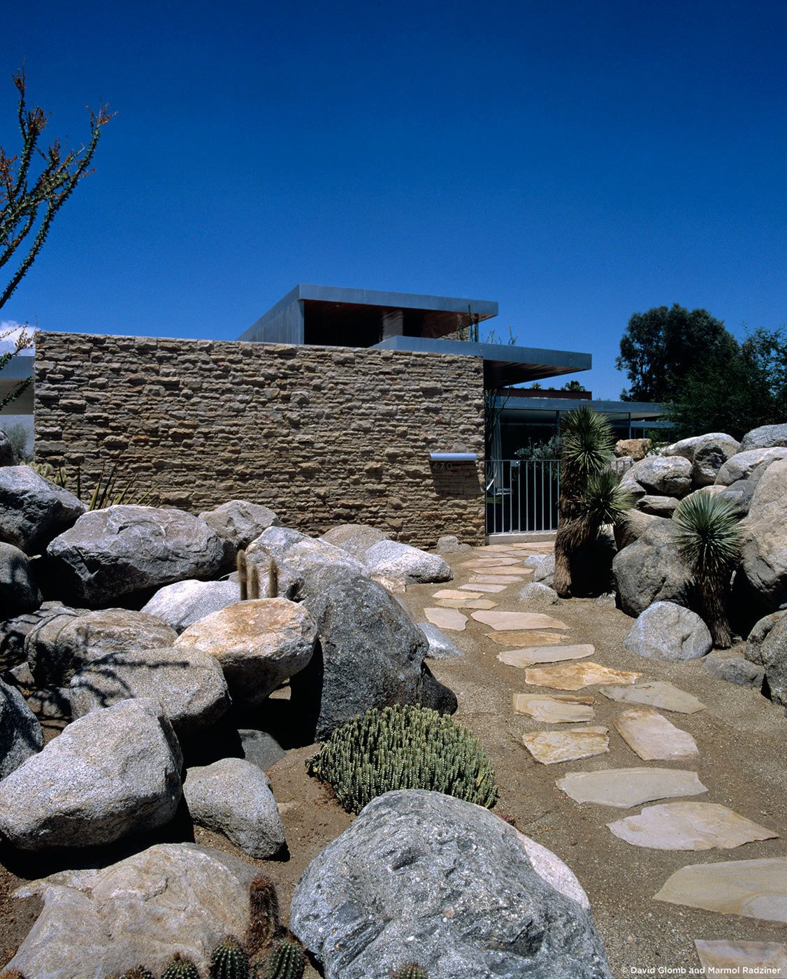 #KaufmannHouse #modern #midcentury #Nuetra #1946 #restoration #archival #original #details #lighting #windows #exterior #outside #outdoors #landscape #pathway #stone #rock #PalmSprings #California #MarmolRadziner   Kaufmann House