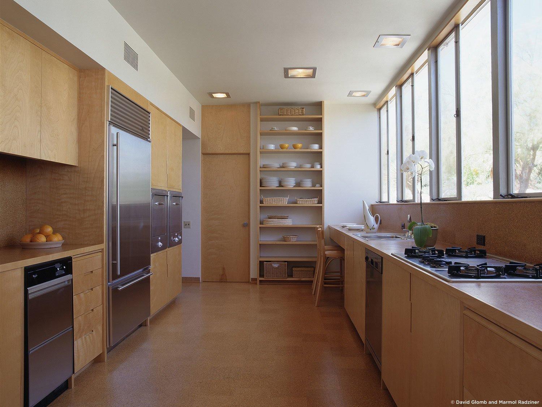 #KaufmannHouse #modern #midcentury #Nuetra #1946 #restoration #archival #original #details #lighting #interior #inside #wood #kitchen #appliances #stove #shelves #PalmSprings #California #MarmolRadziner   Kaufmann House