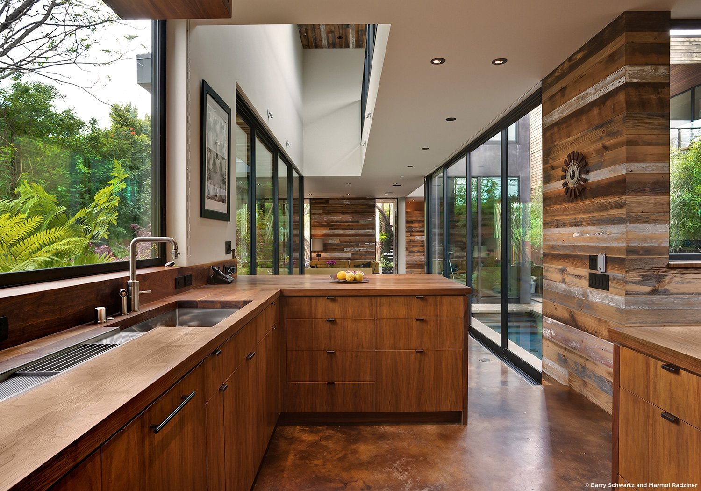 #SelaResidence #modern #midcentury #privacy #openness #two-story #lighting #interior #inside #kitchen #appliances #storage #windows #glass #wood #panels #Venice #California #MarmolRadziner  Sela Residence